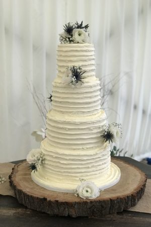 Elegant wedding cake with real flowers Essex